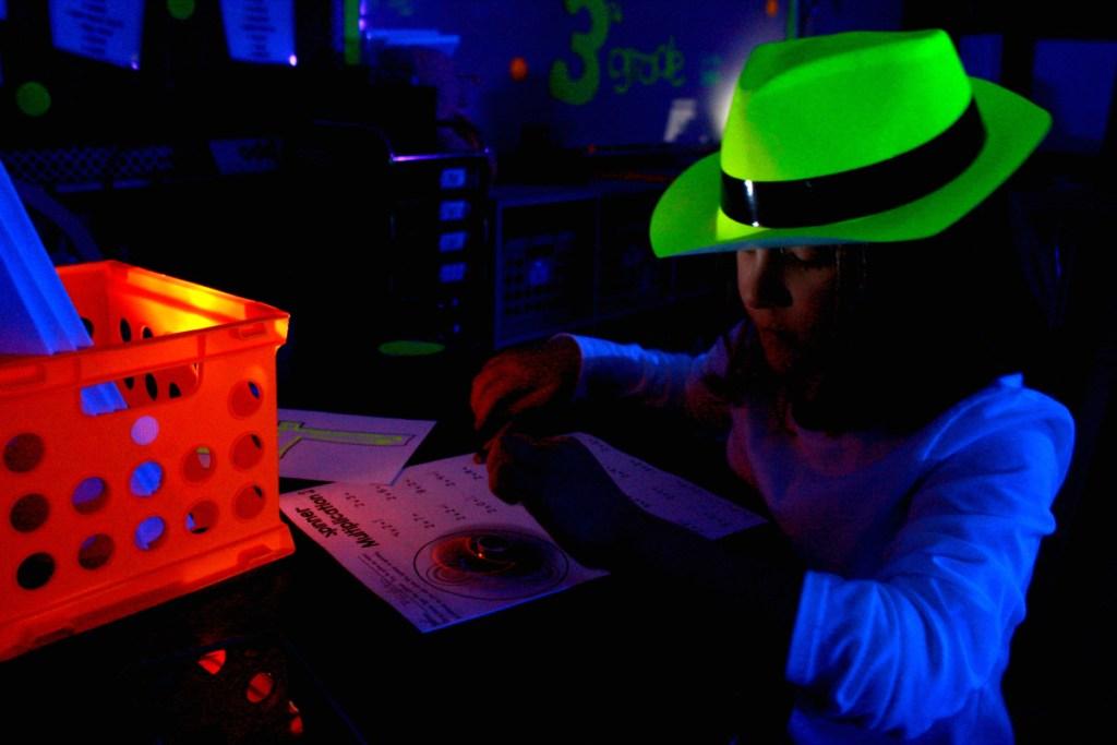 girl playing game in dark