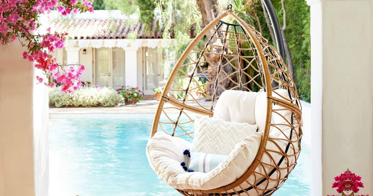 hanging egg chair in front of water