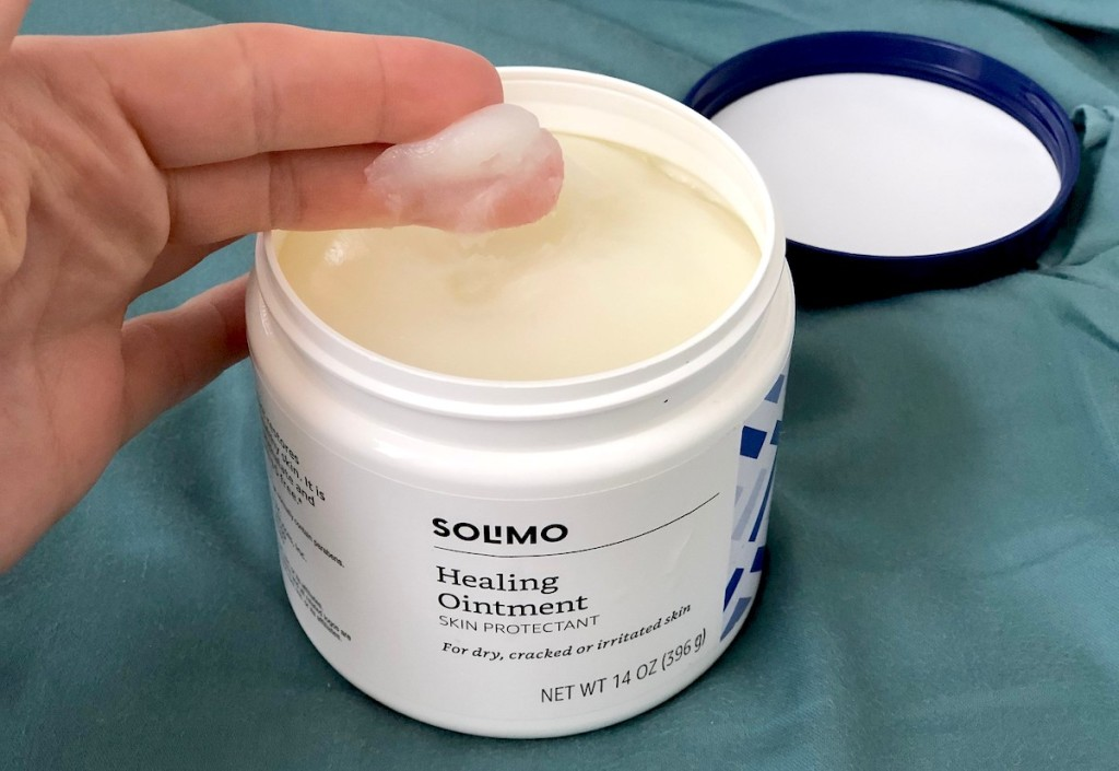 fingers dipped in Solimo Amazon healing ointment