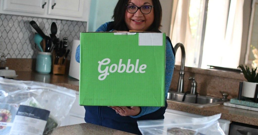 woman holding green Gobble meal box kit
