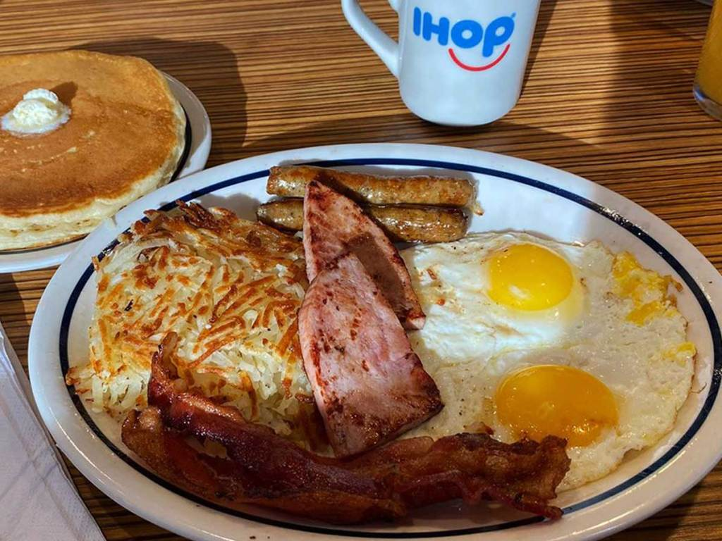 ihop plate of food including ham bacon sausage and eggs