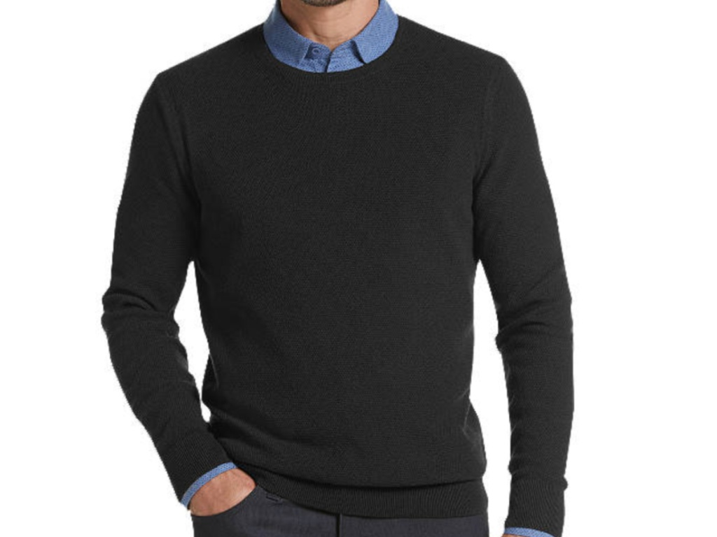 man wearing black sweater over blue collared shirt