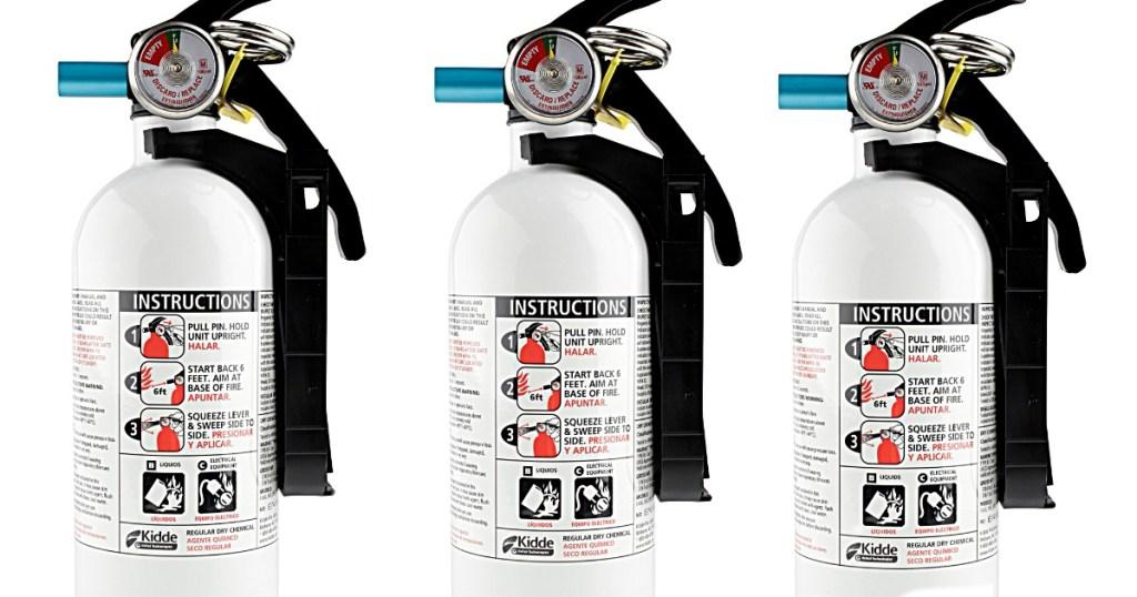 stock image of three fire extinguishers