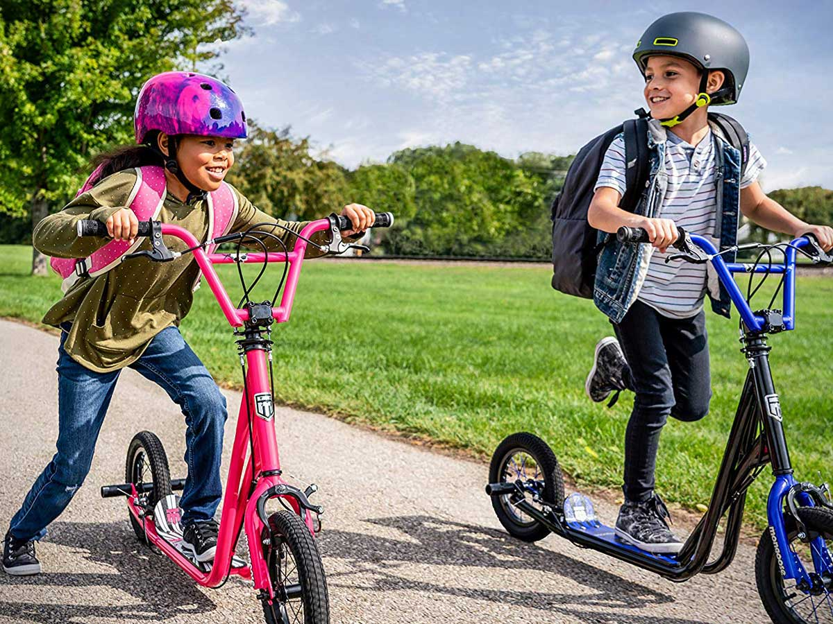 kids riding on mongoose scooters