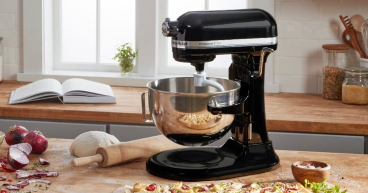black kitchen aid stand mixer on counter with ingredients all around the hmachine
