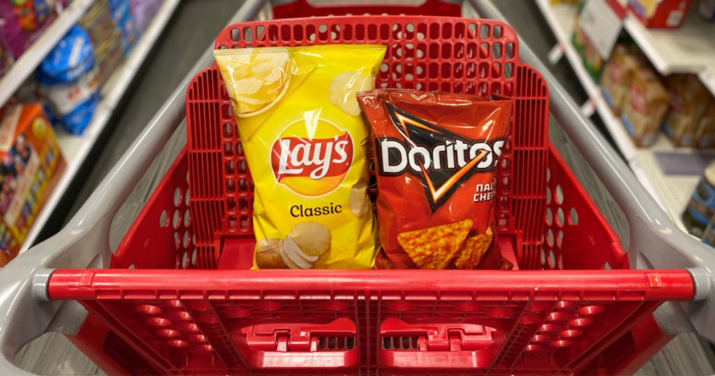 bag of yellow lays and red doritos in the target cart