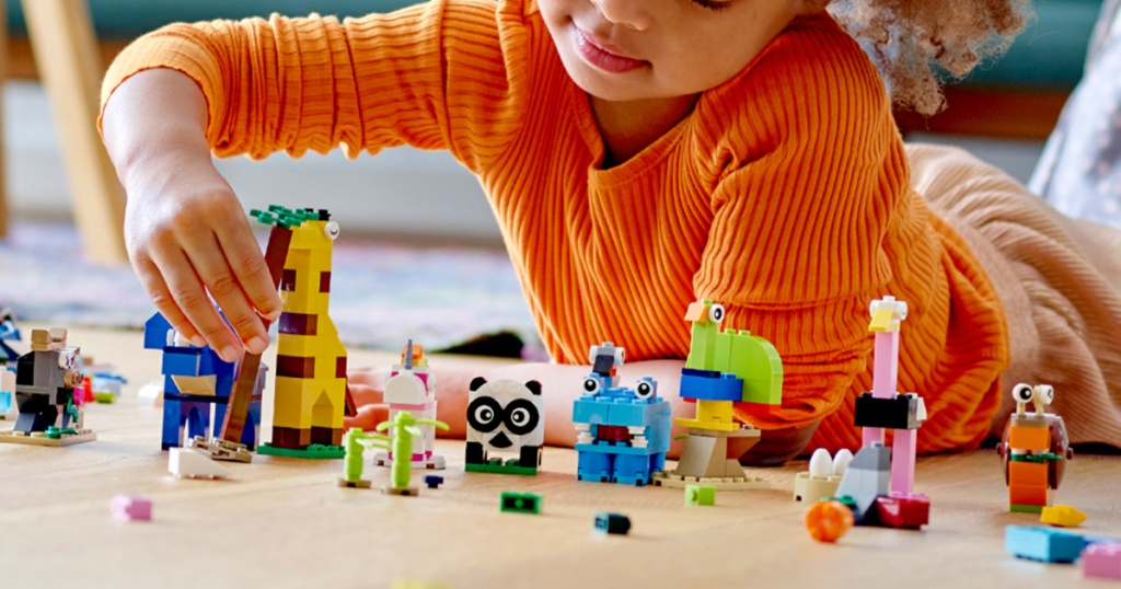 lego classic animal set with little boy playing