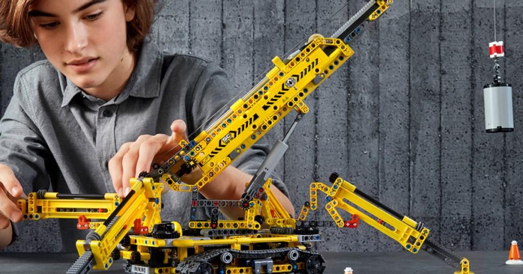 lego technic crane and kid building