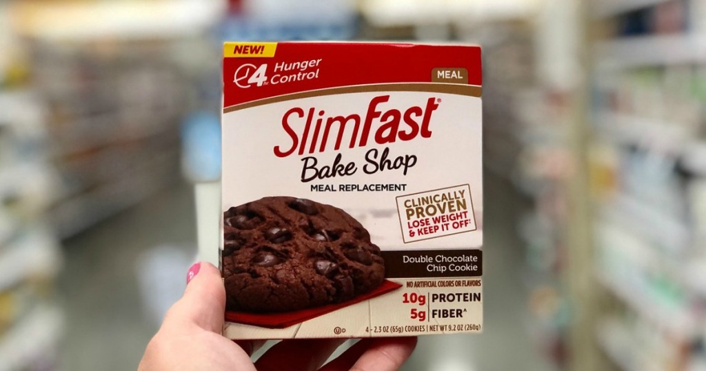 Woman's Hand holding up SlimFast Bake Shop Cookies