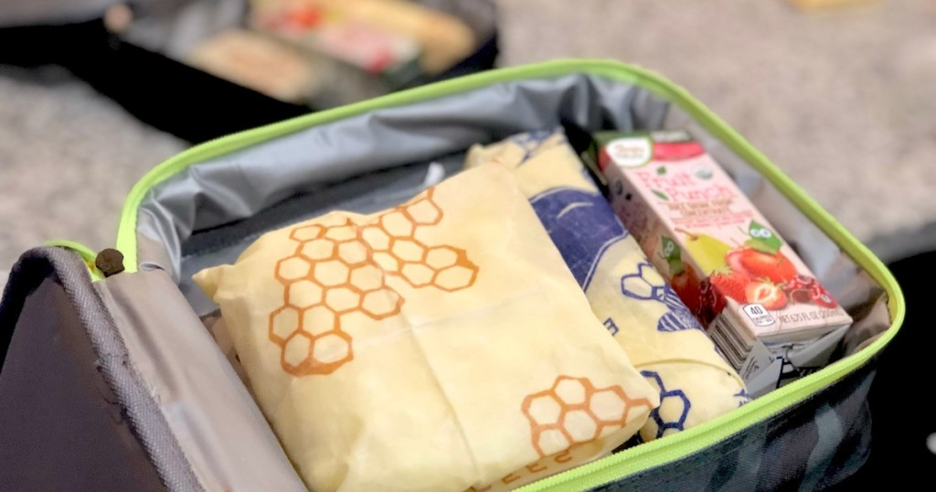 open lunch box with bees wraps and juice box inside