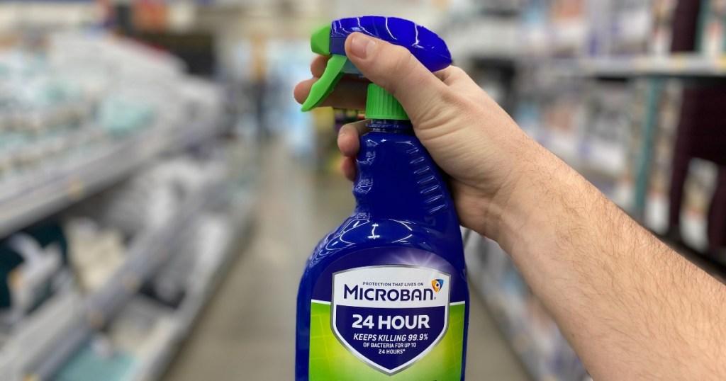 hand holding Microban spray