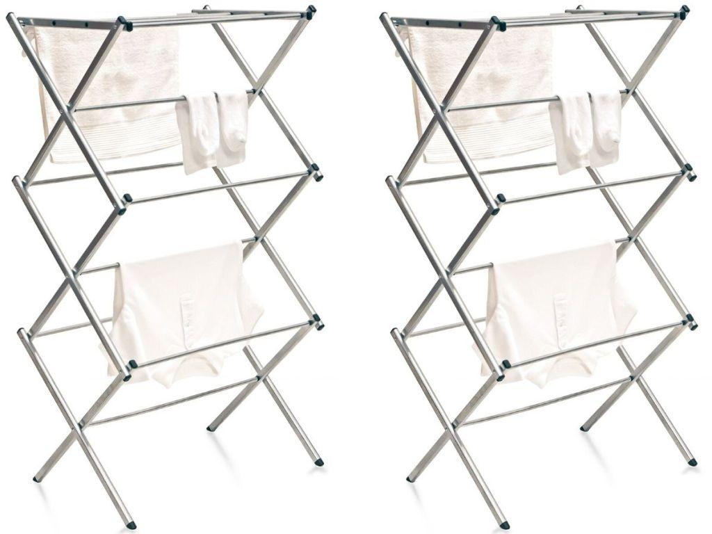 two metal folding drying racks with clothes hanging on them drying