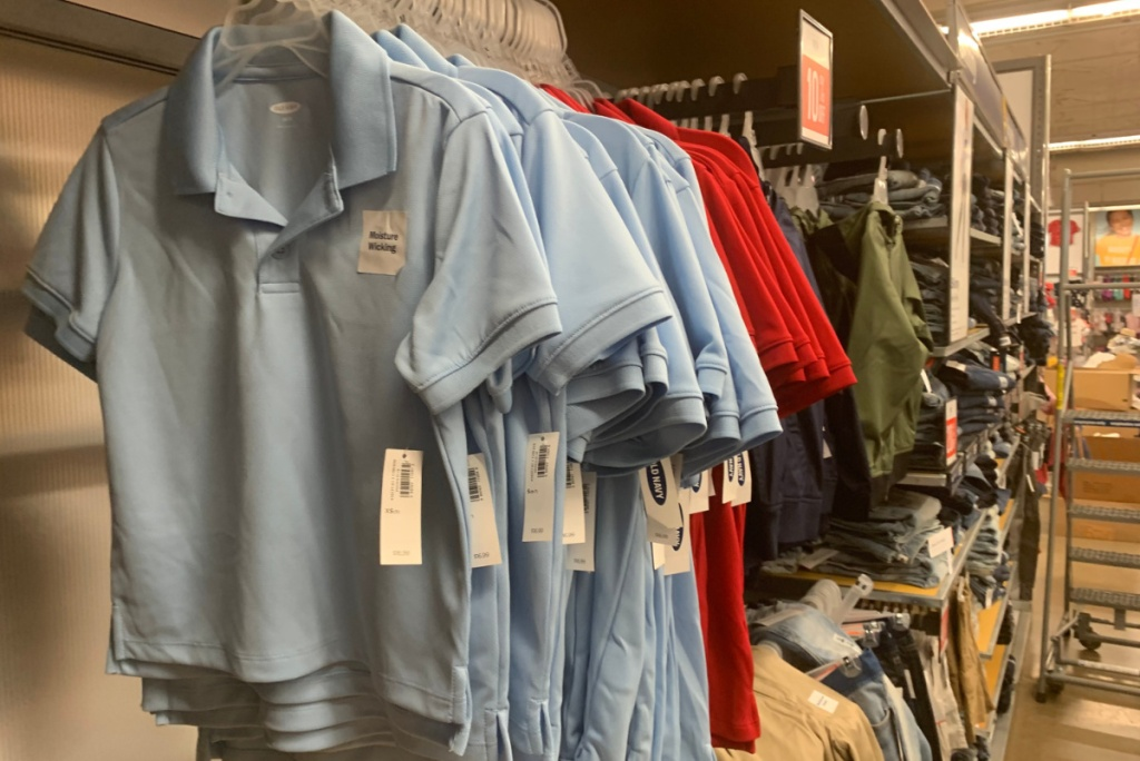 powder blue and red polos hanging in store