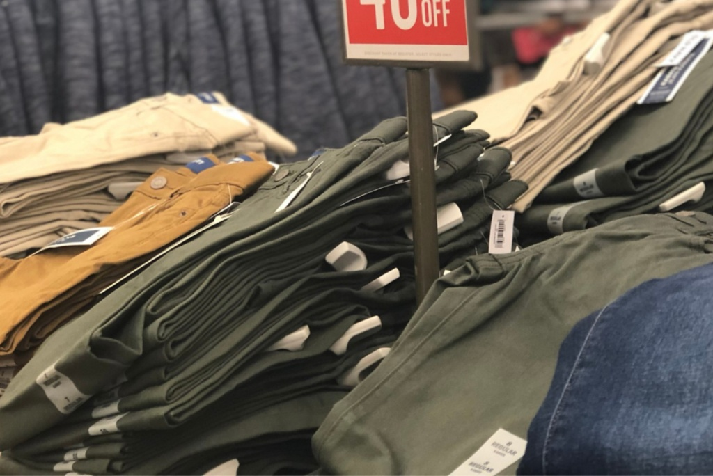 old navy mens pants on display in store on table