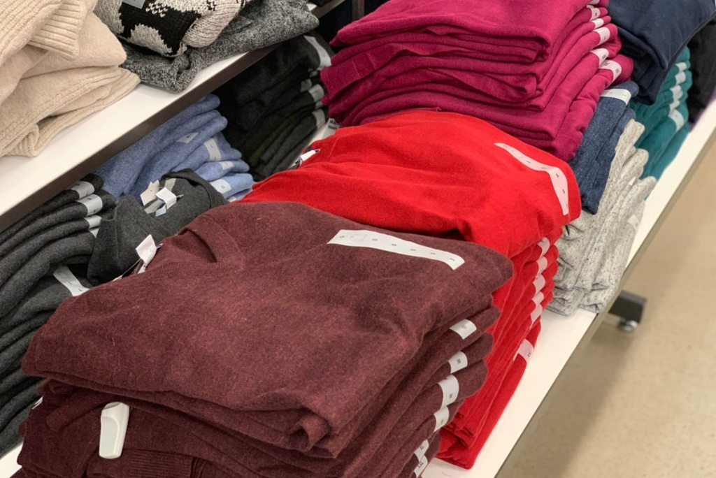 colorful sweaters on store shelf