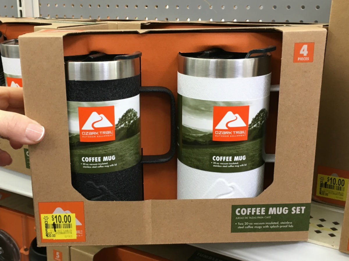 hand holding box with 2 mugs in it on store shelf