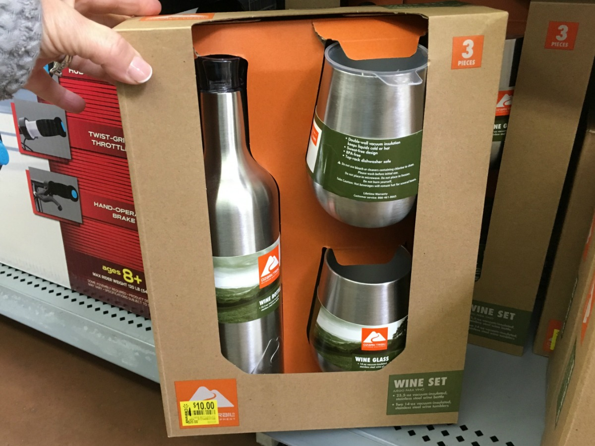 hand showing a box of silver mugs on store shelf