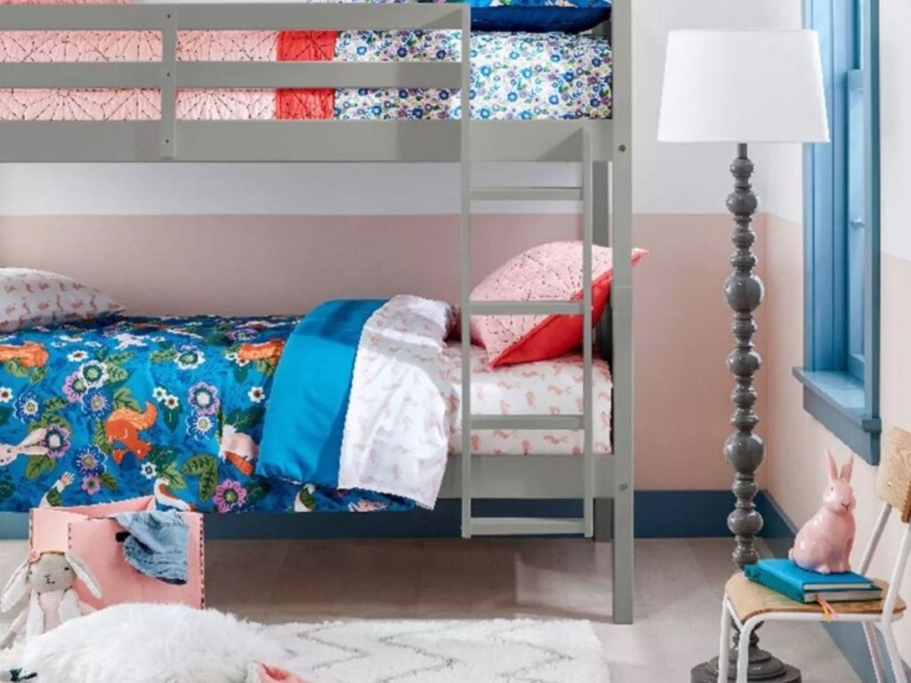 childrens bedroom with bunkbeds, rug, lamp and chair