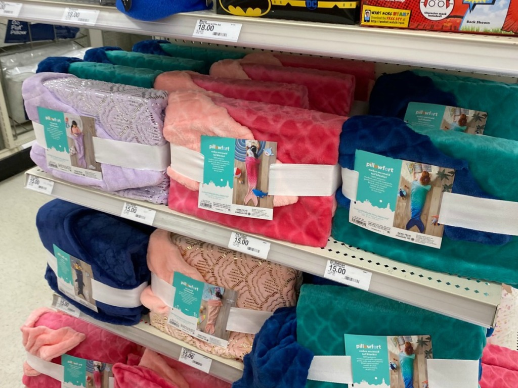 store shelf with several colors of plush mermaid tails