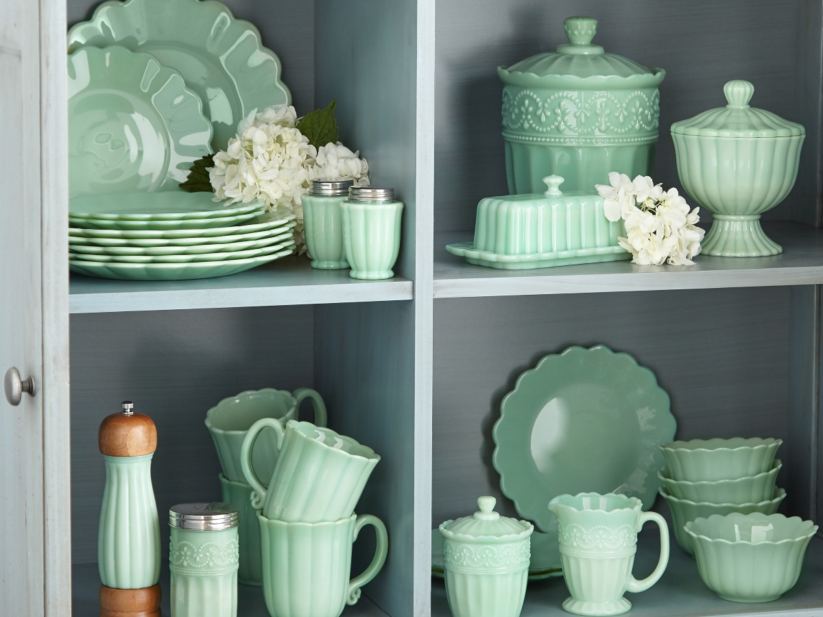 Pioneer Woman jade tabletop collection on gray shelves