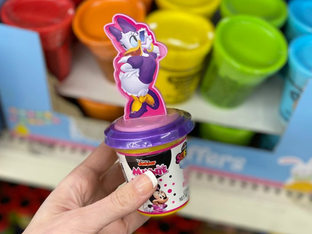 hand holding cup with a duck character on top