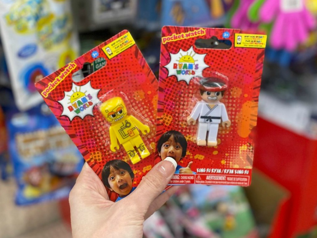 hand holding little packs with toys in them