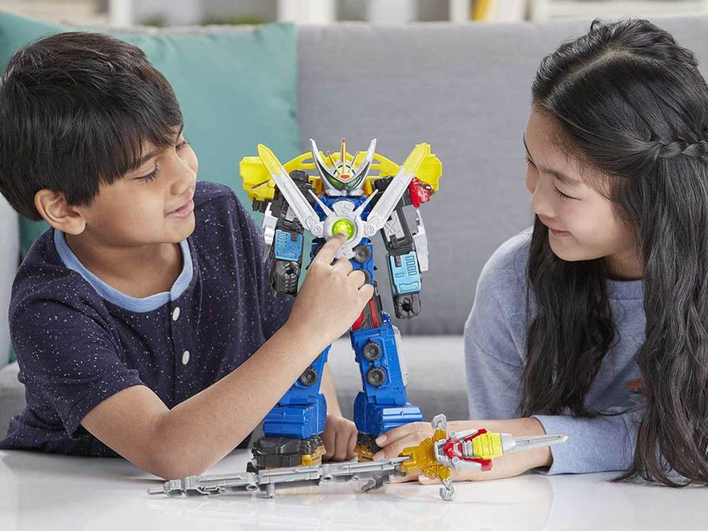 boy and girl playing with power rangers ultrazord toy