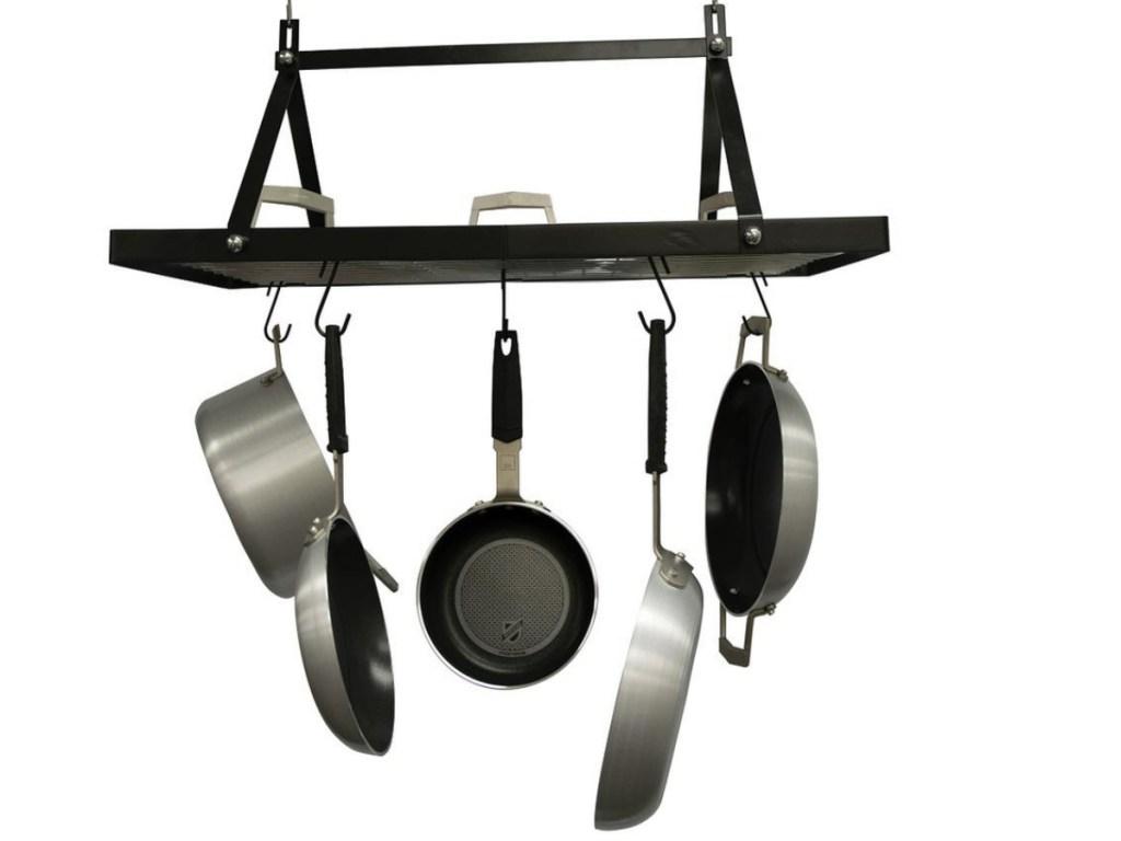 black pot rack holding pots and pans