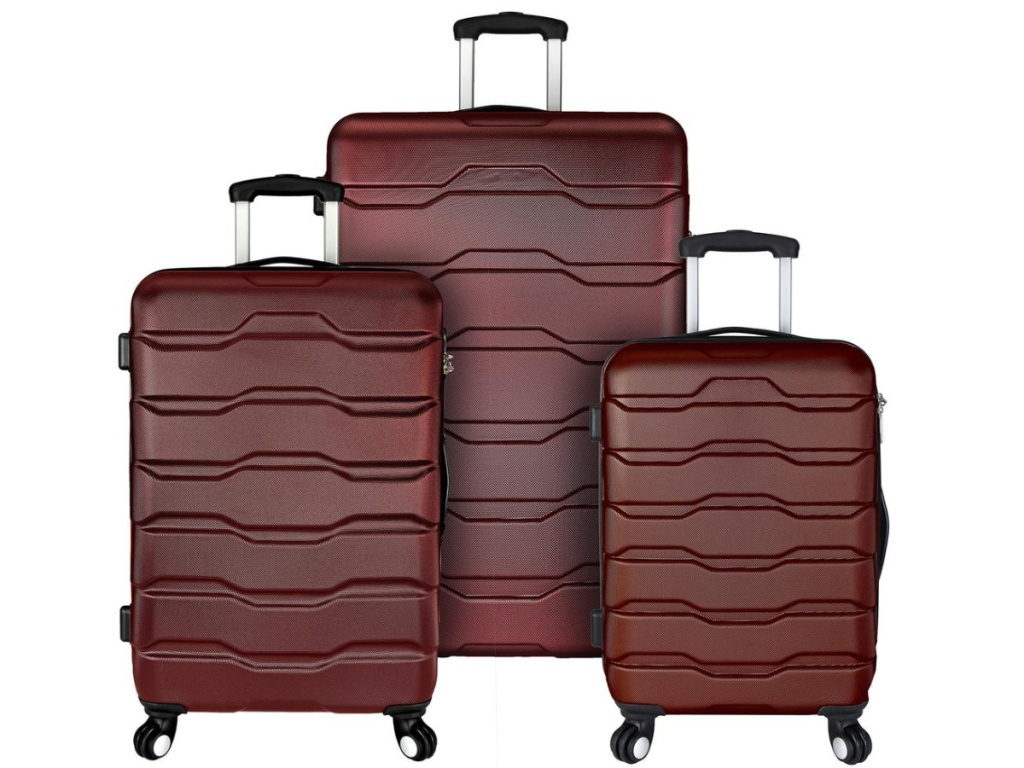 red hard luggage with wheels