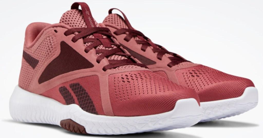 pair of dark pink and maroon Reebok shoes
