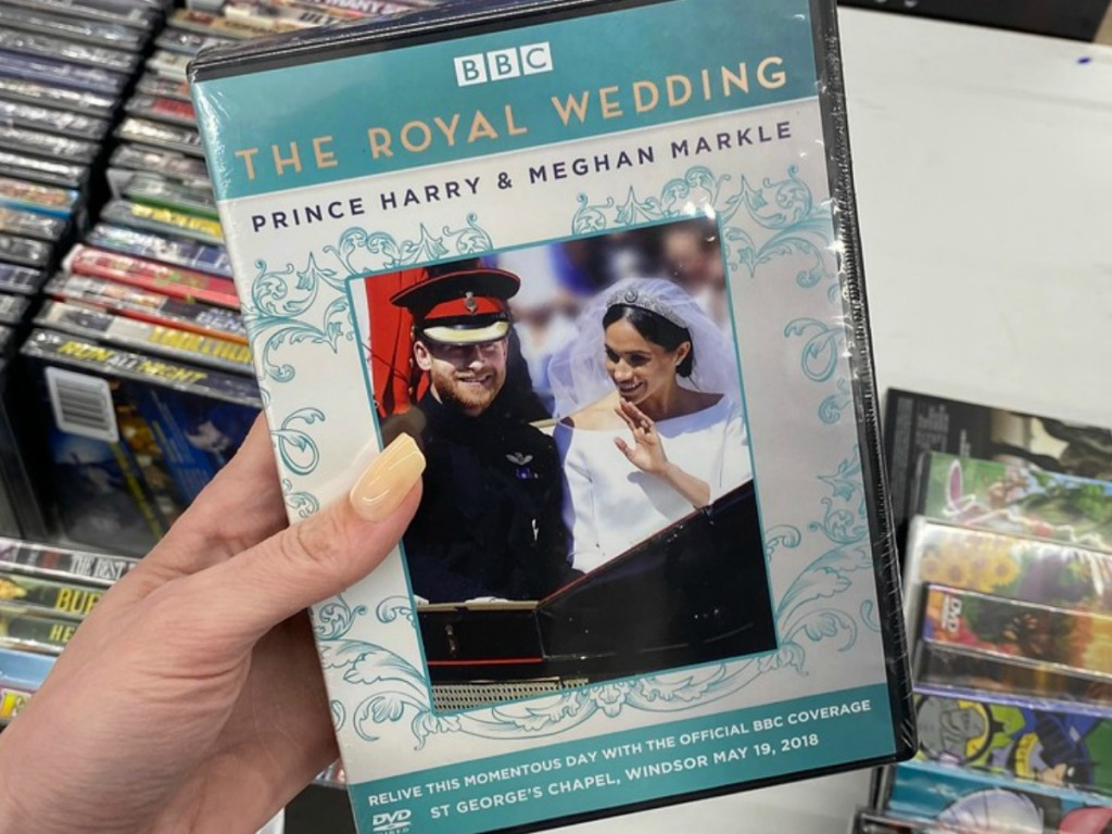 hand holding DVD with Royal Wedding by store display