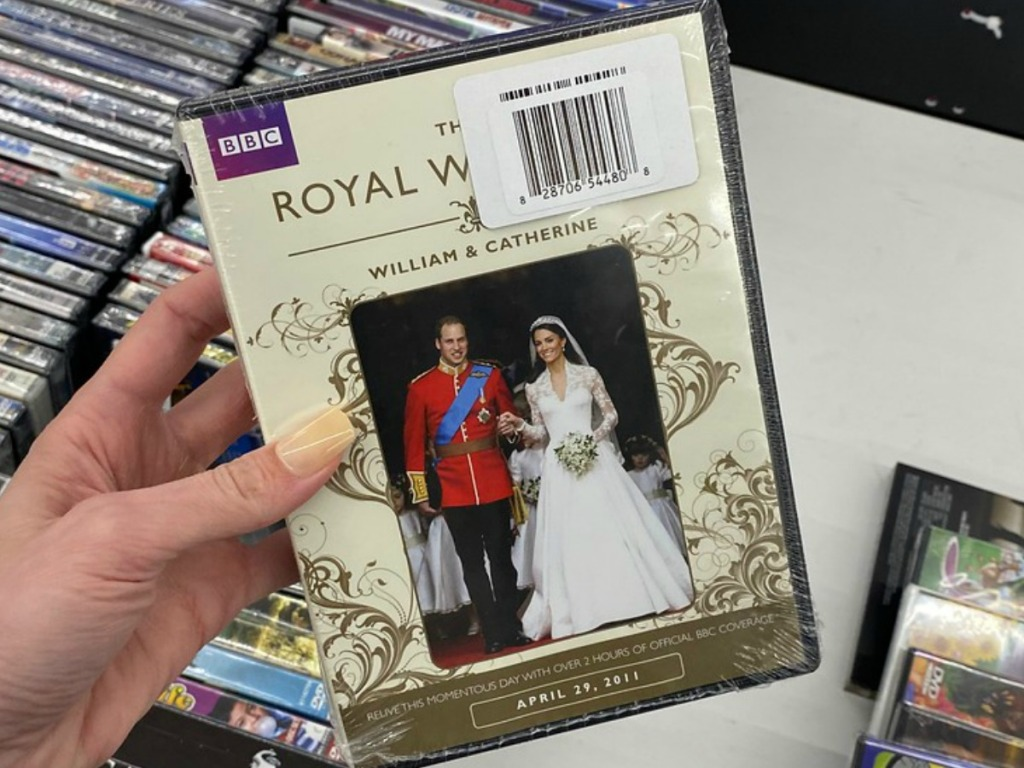 hand holding DVD with wedding couple pictured on it