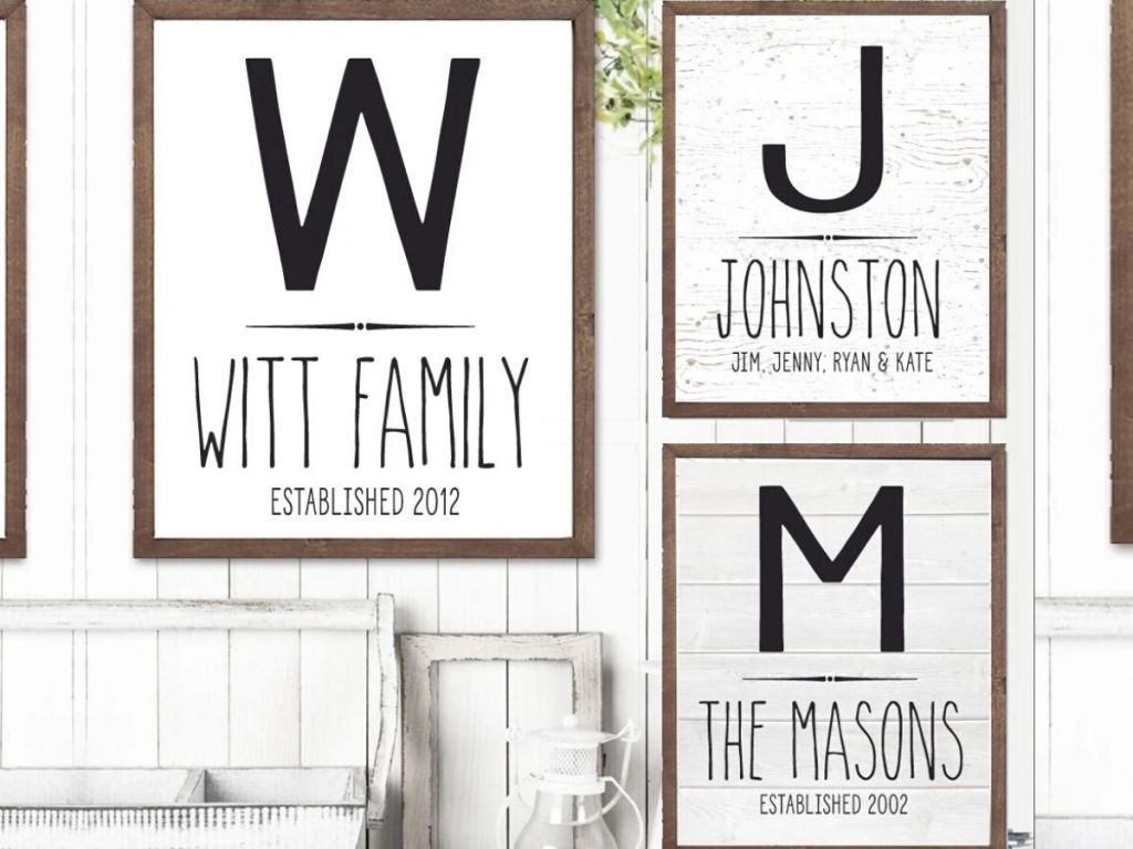three rustic framed signs hanging on wall
