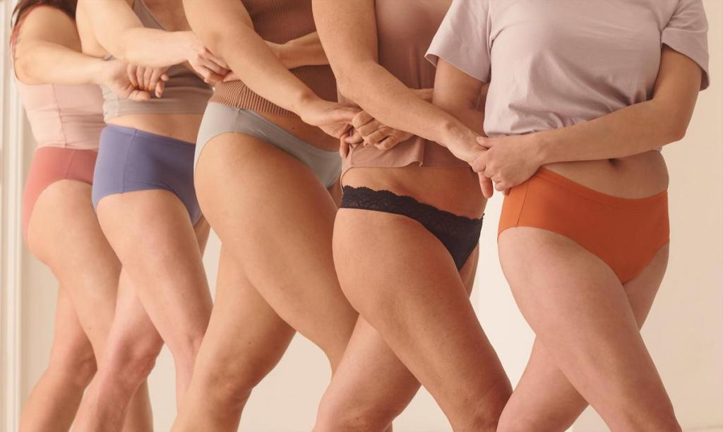 women wearing colorful underwear and holding hands