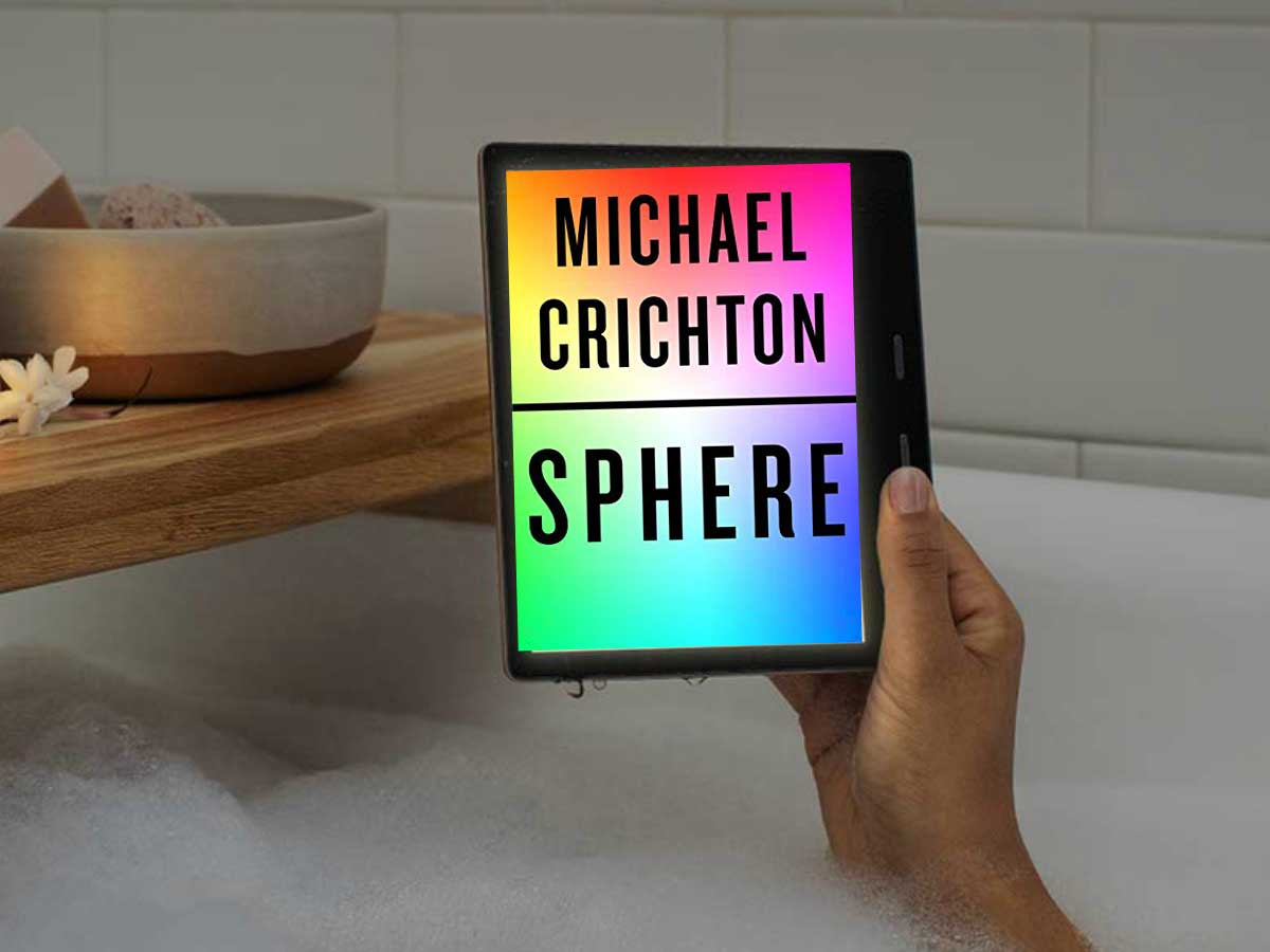 the book Sphere by Michael Crichton being held up in the bathtub