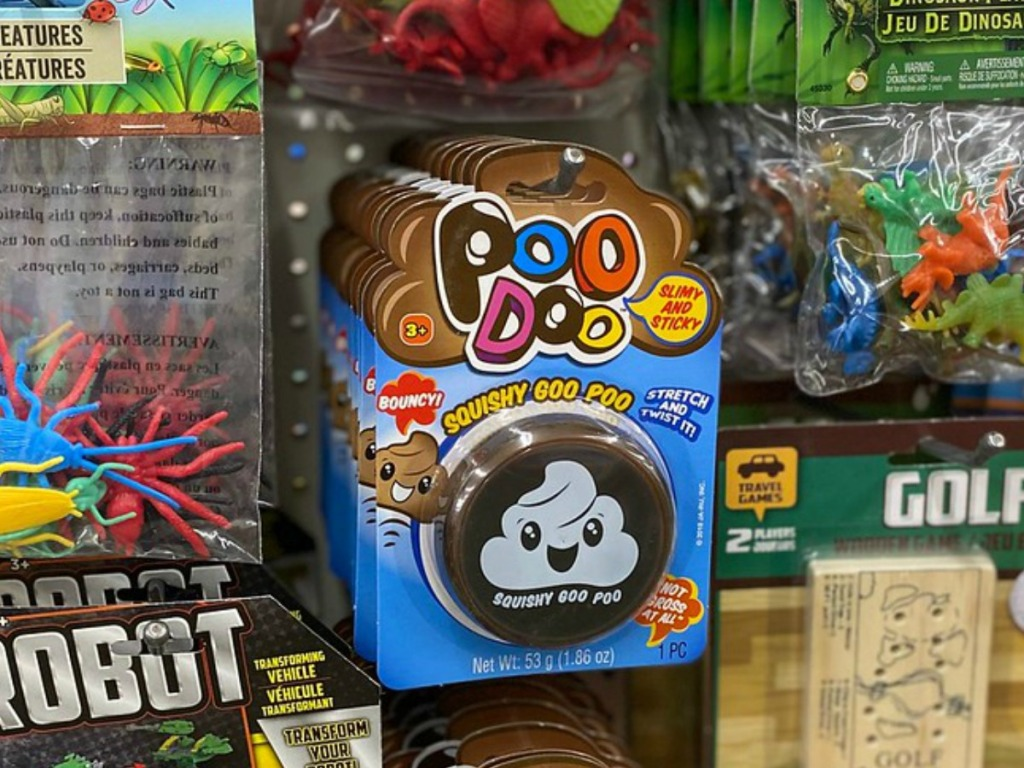 store display with toys including a squishy poo toy