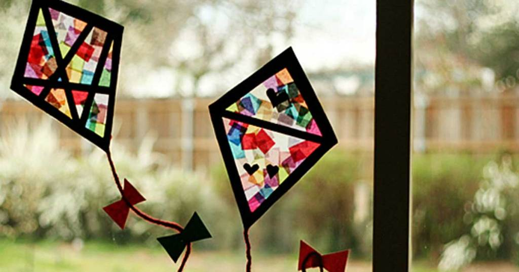 stain glass homemade kites in a window