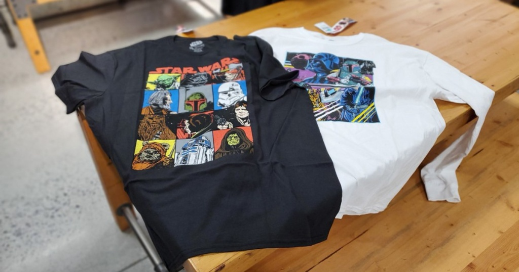 two star wars graphic tees on display in store
