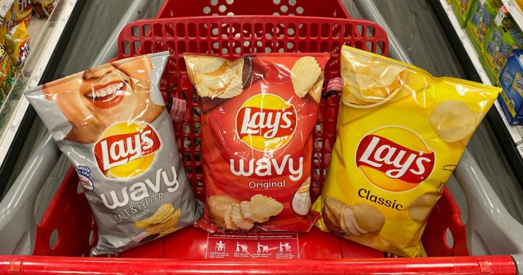 bags of potato chips in a store shopping cart