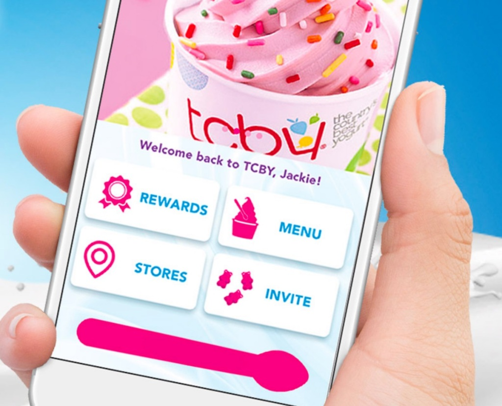 hand holding phone with tcby app