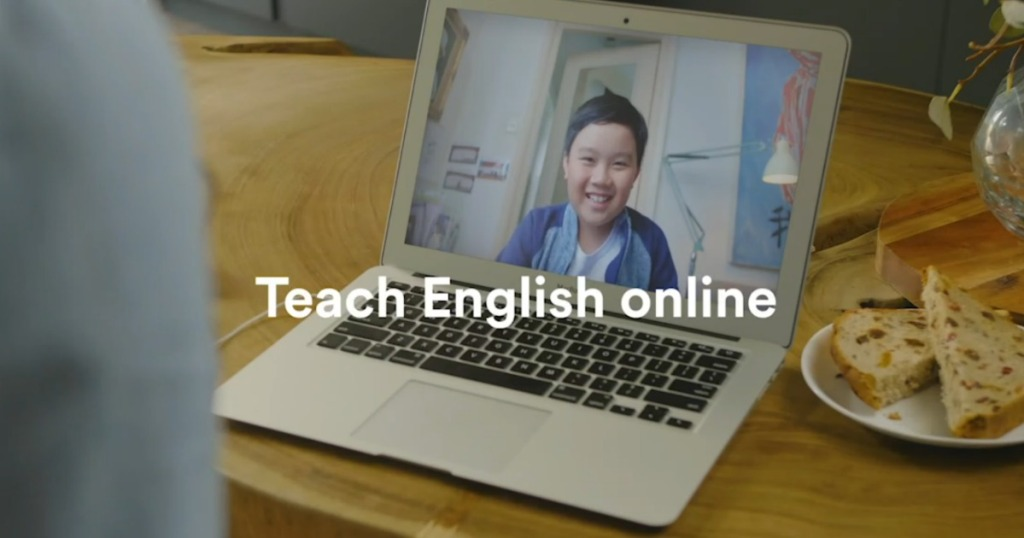 boy learning english online with laptop