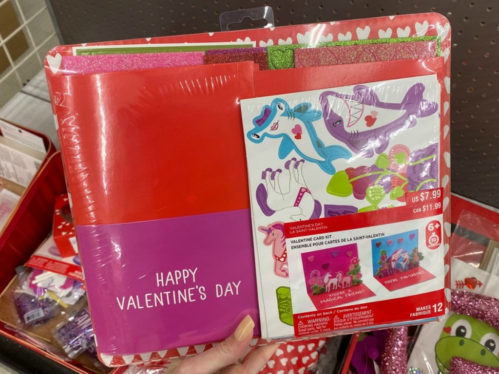 hand holding red box with Valentine's projects inside
