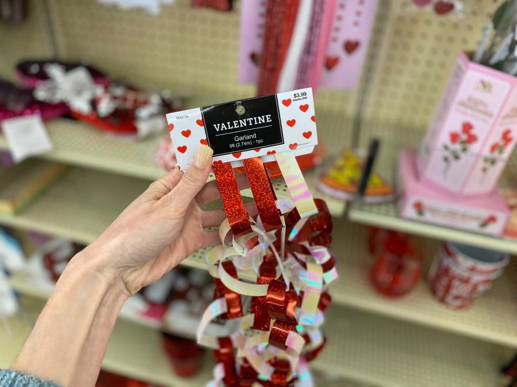 hand holding valentine's day decor