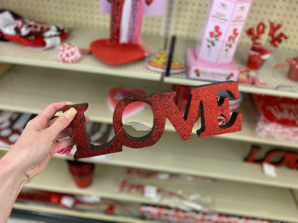 hand holding love sign in store