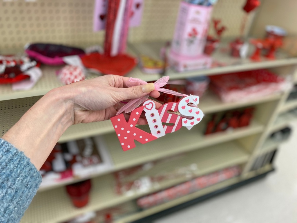 hand holding Kiss ornament in store