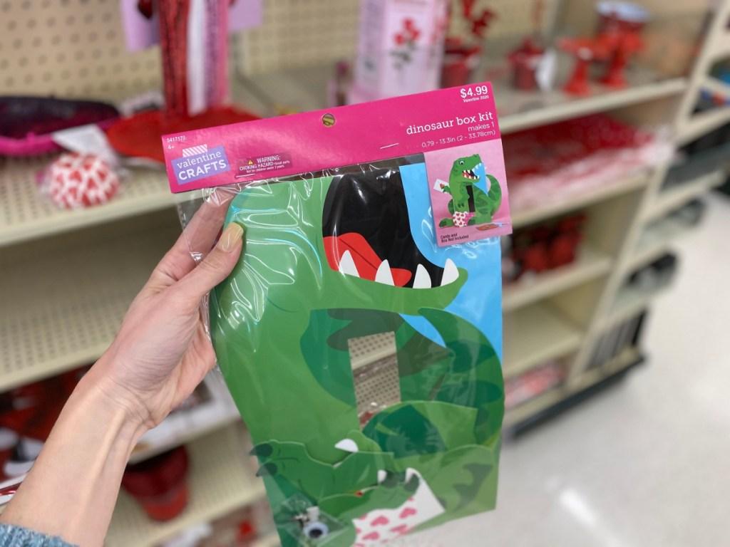 hand holding dinosaur kit in store