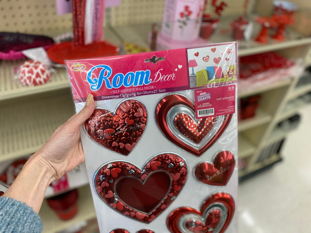 hand holding room decor wall stickers in store