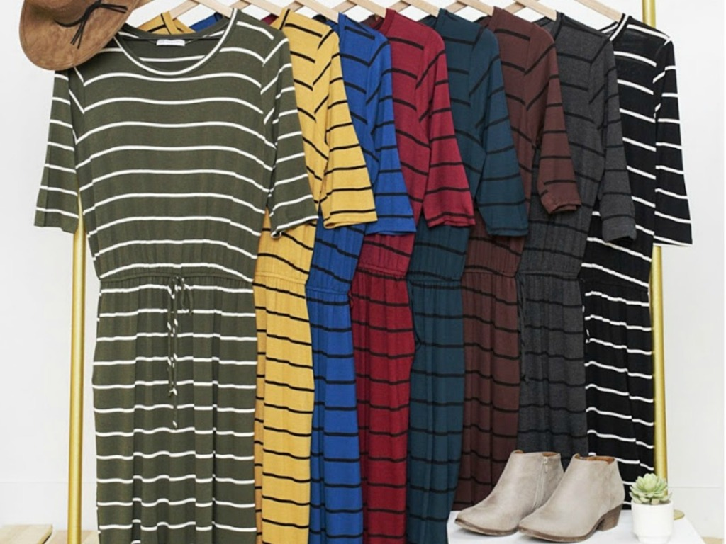 rack with different colored stripe dresses hanging on it