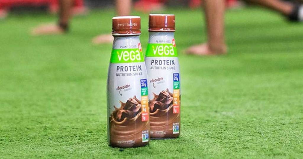 two bottles of protein shakes on the football field