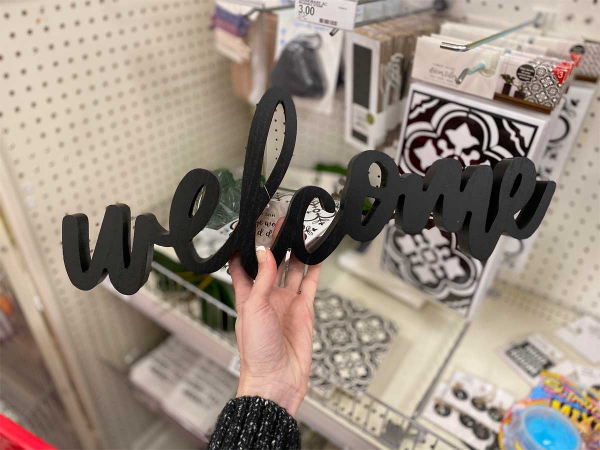 hand holding Large Home Wood Word Decor